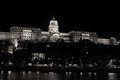 Buda castle seen across the danube at night budapest hungary Stock Image