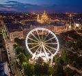 Budapest, Hungary - Aerial drone view of Elisabeth square at blue hour with illuminated ferris wheel and St. Stephen`s Basilica Royalty Free Stock Photo