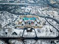 Budapest, Hungary - Aerial view of the famous Szechenyi Thermal bath from above in the snowy City Park