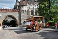 Budapest hungary circa july bierbike with tourists is entering the gate vajdahunyad castle in main city park in Stock Image