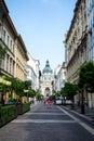 BUDAPEST, HUNGARY - JULY 24, 2016: A street of Budapest and St. Stephen`s Szent Istvan Basilica
