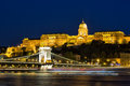 Budapest by night - Night view of the Szechenyi Chain Bridge, that spans the River Danube between Buda and Pest and Buda Castle Royalty Free Stock Photo