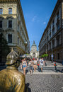 Budapest street may turists on a a view of szent istvan church and hungarian policeman in foreground on in Stock Images