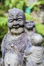 Budda stone monument in garden Stock Photo