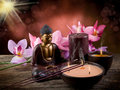 Buddah with candle and incense Royalty Free Stock Photo