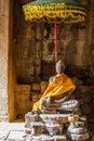 Buddah statue and unbrella Royalty Free Stock Photo