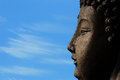 A buddha against a blue sky for enlightenment with clouds meditation and Stock Image