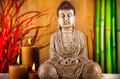 Buddha with candle, vivid colors, natural tone Royalty Free Stock Photo