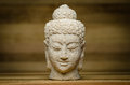 Buddha centered image of a head against wood background Stock Photography