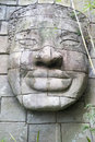 Buddha face carved in stone a big boulders of Stock Images
