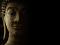 Buddha face with light and shadow. Royalty Free Stock Photo