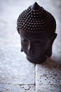 Buddha face still life with sculpture Royalty Free Stock Photography