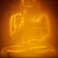 Buddha in gold julian bound an abstract golden holding up hand Royalty Free Stock Photography