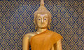 Buddha gold statue on golden and blue background patterns Thaila Royalty Free Stock Photo