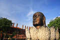 Buddha head at wat thammikarat in in ayutthaya thailand on lotus statue against blue sky Royalty Free Stock Photo