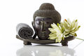 Buddha head on a white background, towel and lotus Royalty Free Stock Photo