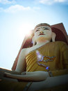 Of buddha his direction points in myanmar temple on blue sky Stock Photo