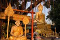 Buddha image and holy man sitting under Bodhi tree