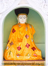 Buddha image at the shwedagon pagoda with an orange robe in yangon capital of republic of union of myanmar Royalty Free Stock Images