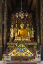 Buddha images dark interior wat phra lampang luang buddhist temple lampang near chiang mai northern thailand Royalty Free Stock Photography