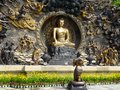 Buddha murals statue at lingshan a bronze with his disciple kneeling in the front to pary in wuxi city jiangsu province china Royalty Free Stock Photos