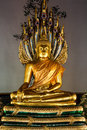 Buddha and naga golden sculpture of meditating Stock Photography