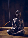 Buddha portrait joss stick lit with and smoke Royalty Free Stock Photos