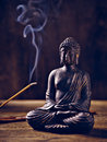 Buddha portrait joss stick lit with and smoke Stock Image