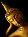 Buddha reclining the face of is a very elegant Stock Photos