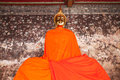 Buddha s image covered with yellow orange robe at wat suthat bangkok thailand Stock Photos