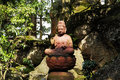 Buddha sakyamuni statue with trees and rock the of sit on stone lotus in the corner of forest Stock Photography