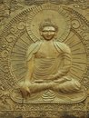 Buddha, sculpture, bas-relief, election on wall, covered with golden paint.