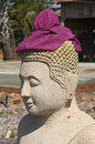 Buddha sculpture with krama head cover cambodia Stock Photos
