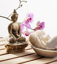 Buddha for serenity at beauty center pampering exfoliation with loofah and pumice stone with faith in buddhism Royalty Free Stock Images