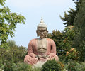 Buddha sitting in meditation Royalty Free Stock Photos