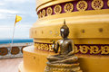 Buddha statue at base of pagoda at hilltop temple in southern thailand Royalty Free Stock Photography