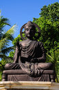 Buddha statue black in sunny day Royalty Free Stock Image