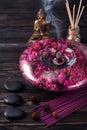 Buddha statue, essential oils, incense sticks and stones massage Royalty Free Stock Photo