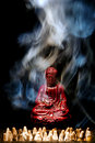 Buddha Statue Figurine in Smoke Royalty Free Stock Photo