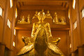 Buddha statue golden in a buddhist temple Stock Photos