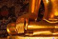 Buddha statue golden right hands Royalty Free Stock Photography