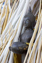 Buddha statue in the group of branch wood white and natural color Royalty Free Stock Photo