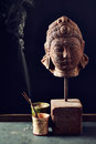 Buddha statue with incense sticks Royalty Free Stock Photo