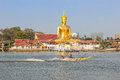 Buddha statue long tailed boat in the river in front the Stock Photo