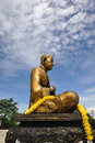 Buddha statue made of brass ecclesiastes phuttha chan to prom radiation background with the blue sky Stock Photo