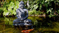 Buddha statue and pond Stock Photo