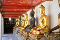 Buddha statue row of in temple in thailand Stock Photos
