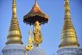 Buddha statue on top of pagoda around Shwedagon Pagoda - Yangon, Royalty Free Stock Photo