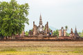 Buddha statue in wat mahathat temple sukhothai historical park at sunrise thailand Stock Image