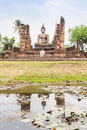 Buddha statue in wat mahathat temple sukhothai historical park at sunrise thailand Stock Photo